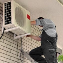 aircool staff install new air conditioner unit